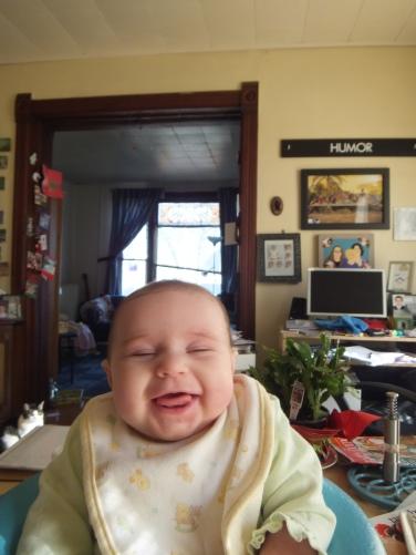 Lu, making a joyful noise at three months